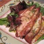 Pan Seared Dover Sole over Fresh Greens with a Spicy Orange Vinaigrette