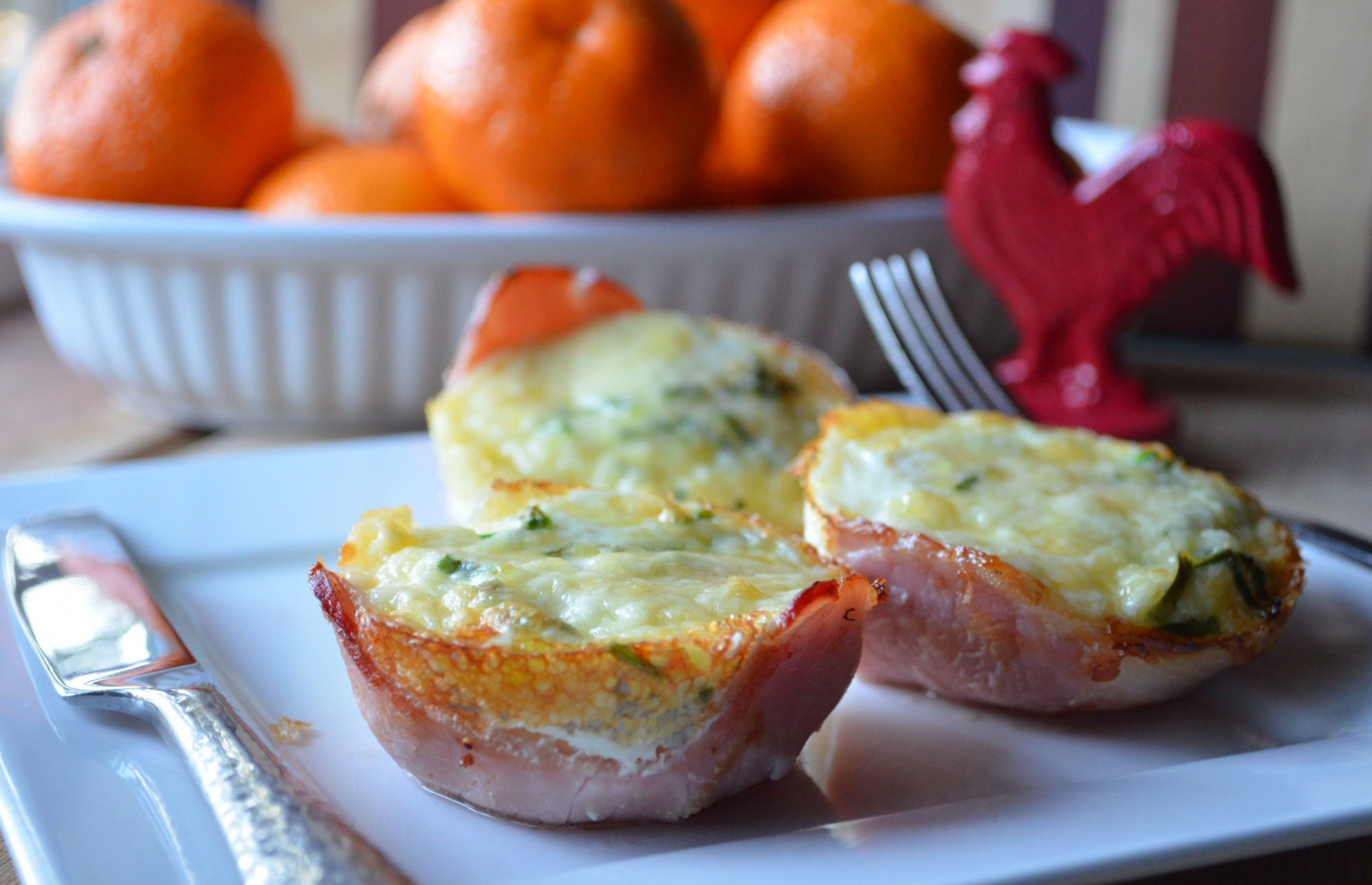 Soft baked eggs and cheese in Canadian bacon