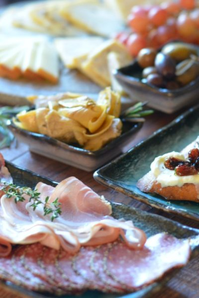 Antipasti platter with crostini, salumi, and cheese