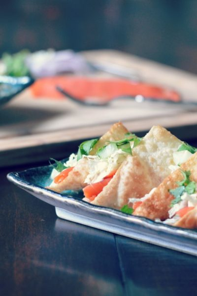 Smoked salmon, napa cabbage, cilantro, cucumber, red onion with a spicy sauce in a wonton taco shell