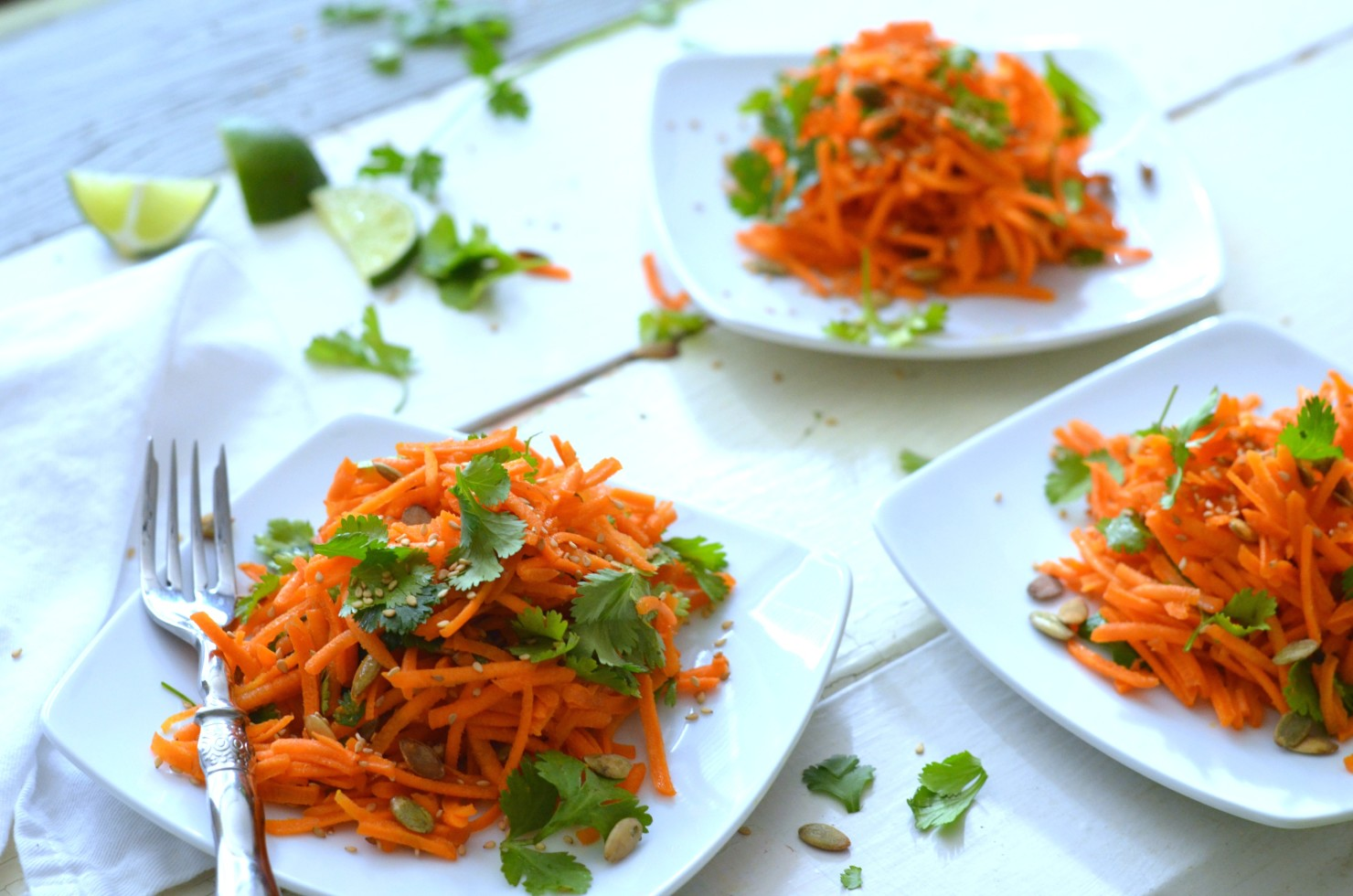 Carrot Cilantro Salad with Ginger Peanut Dressing and Pumpkin Seeds
