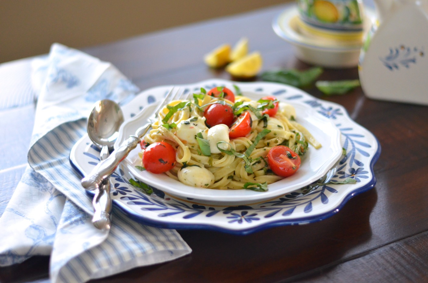 Fettuccine Caprese with fresh cherry tomatoes, basil and mozzarella balls