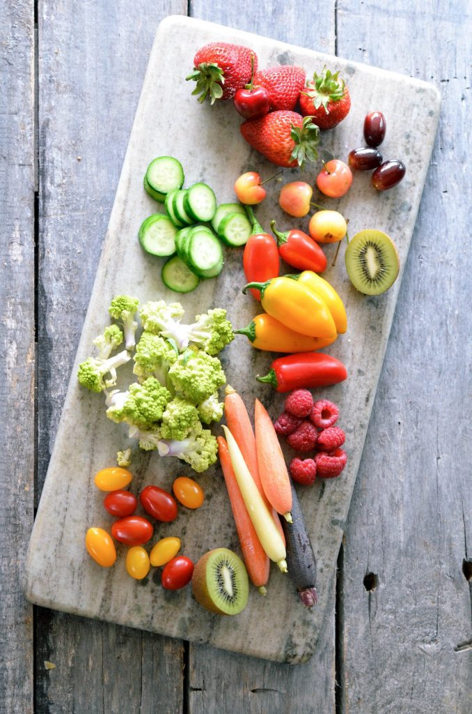 A selection of assorted fresh fruit and vegetables that one might use on a vegetable and cheese board.