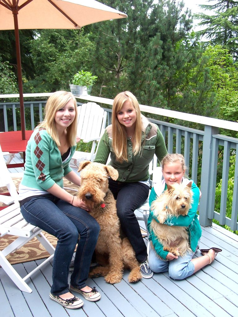 My daughters with their dogs Elwood and Reggie for the Linguine with cabbage, wild mushroom and truffle post on KaristaBennett.com